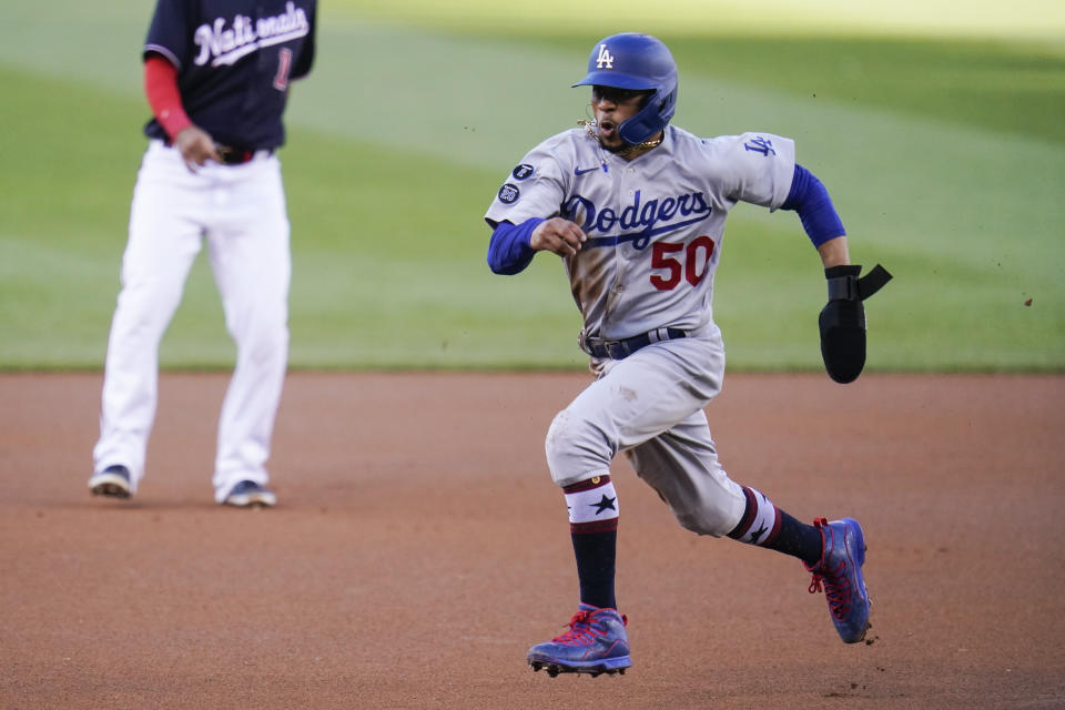 Los Angeles Dodgers' Mookie Betts tries to tag up against the Washington Nationals during the first inning of a baseball game, Friday, July 2, 2021, in Washington. (AP Photo/Julio Cortez)