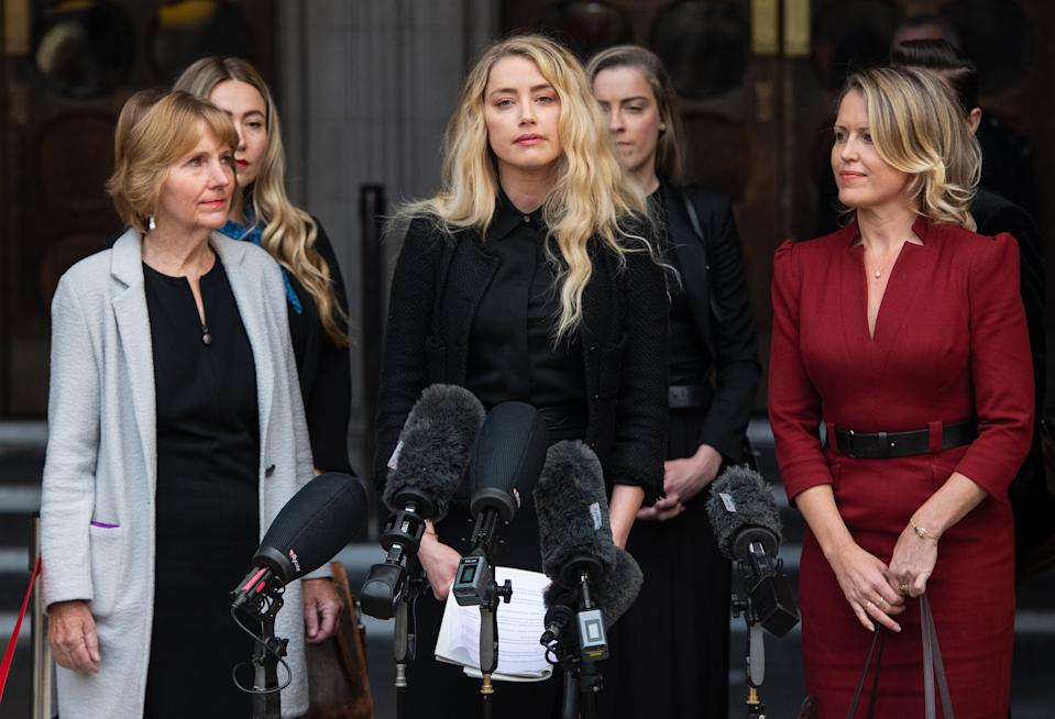 Amber Heard reads a statement after the libel trial at the Royal Courts of Justice in London on July 28, 2020. (Photo by Samir Hussein/WireImage)