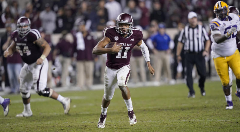 Texas A&M quarterback Kellen Mond (11) rushes for a gain during overtime of an NCAA college football game against LSU Saturday, Nov. 24, 2018, in College Station, Texas. Texas A&M won 74-72 in seven overtimes.(AP Photo/David J. Phillip)