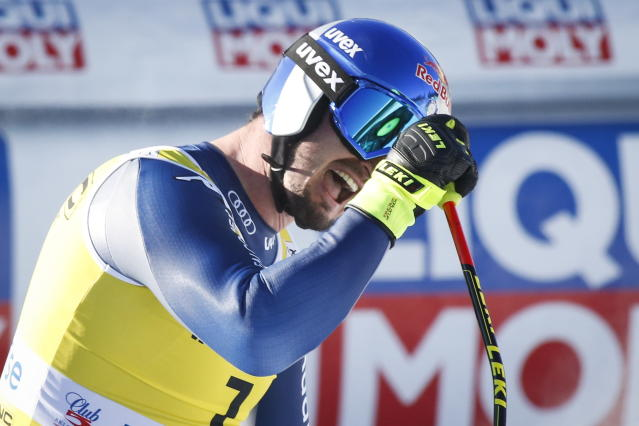 Italy's Dominik Paris reacts in the finish area following his run in the men's World Cup downhill ski race in Lake Louise, Alberta, Canada, on Saturday, Nov. 30, 2019. (Jeff McIntosh/The Canadian Press via AP)