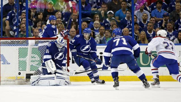 TAMPA, FL - APRIL 16: Dale Weise #22 of the Montreal Canadiens scores the overtime winning goal past goalie Anders Lindback #39 of the Tampa Bay Lightning as defenders Eric Brewer #2, Cedric Paquette #54 and Richard Panik #71 look on in Game One of the First Round of the 2014 Stanley Cup Playoffs at the Tampa Bay Times Forum on April 16, 2014 in Tampa, Florida. (Photo by Mike Carlson/Getty Images)