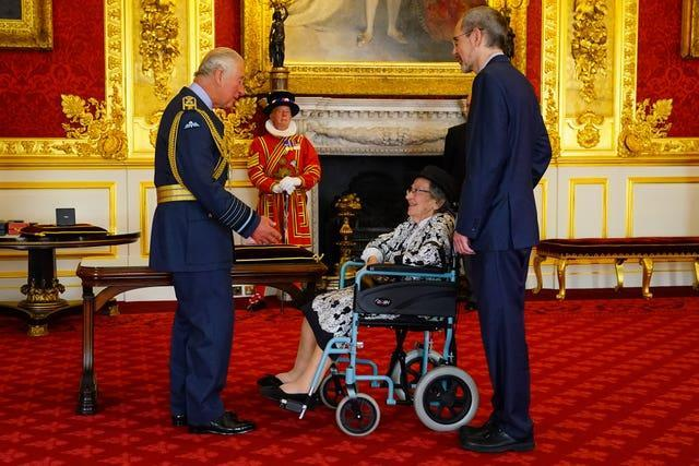 Maria Green from London is made an MBE by the Prince of Wales