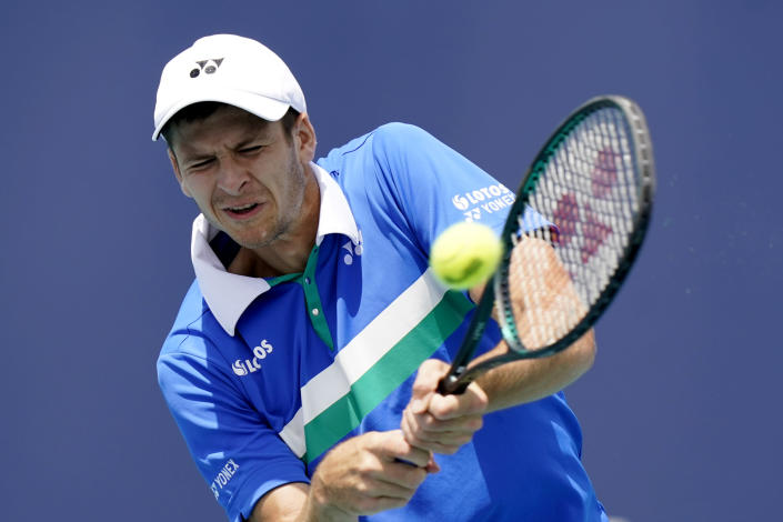 Hubert Hurkacz of Poland returns to Yannik Sinner of Italy during the finals of the Miami Open tennis tournament, Sunday, April 4, 2021, in Miami Gardens, Fla. Hurkacz won 7-6 (4), 6-4. (AP Photo/Lynne Sladky)