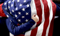 <p>A fan wearing the American flag cheers during the Men's Curling Semi-Final match between United States and Canada at the PyeongChang 2018 Winter Olympics in South Korea, Feb. 22, 2018. United States won.<br>(AP Photo/Aaron Favila) </p>
