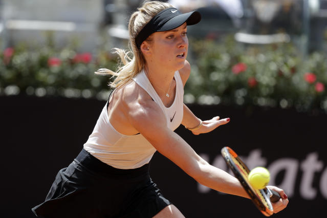 Ukraine's Elina Svitolina returns the ball to Romania's Simona Halep during the final match at the Italian Open tennis tournament, in Rome, Sunday, May 20, 2018. Svitolina won 6-0, 6-4. (AP Photo/Gregorio Borgia)