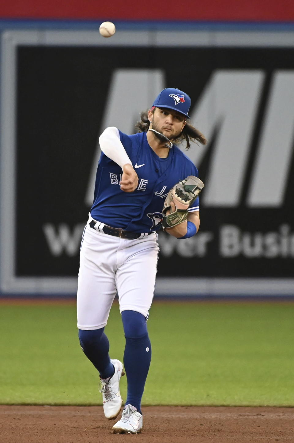 Toronto Blue Jays shortstop Bo Bichette throws to first base to put out Cleveland Indians' Oscar Mercado during the fifth inning of a baseball game Thursday, Aug. 5, 2021, in Toronto. (Jon Blacker/The Canadian Press via AP)