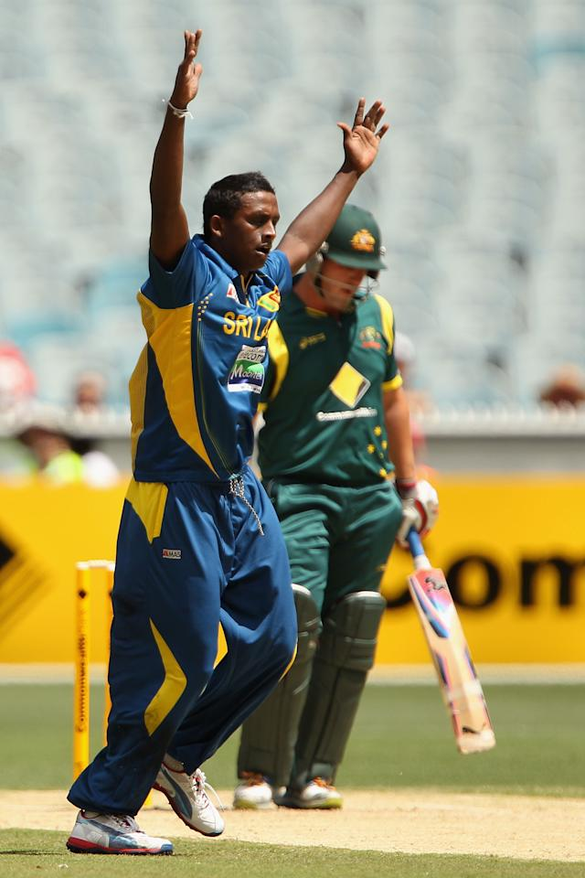 MELBOURNE, AUSTRALIA - JANUARY 11:  Ajantha Mendis of Sri Lanka celebrates the wicket of Aaron finch of Australia during game one of the Commonwealth Bank One Day International series between Australia and Sri Lanka at Melbourne Cricket Ground on January 11, 2013 in Melbourne, Australia.  (Photo by Robert Prezioso/Getty Images)