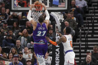 Utah Jazz center Rudy Gobert (27) dunks after getting past New York Knicks guard Elfrid Payton (6) during the second quarter of an NBA basketball game Wednesday, Jan. 8, 2020, in Salt Lake City. (AP Photo/Chris Nicoll)