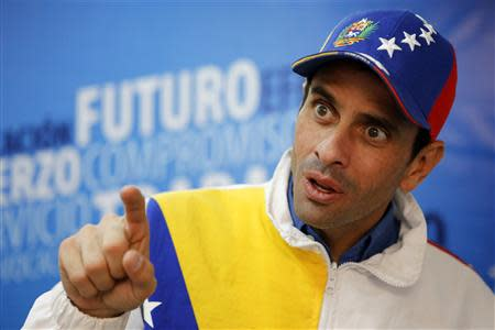 Miranda's state governor and opposition leader Henrique Capriles speaks during an interview with Reuters in Caracas February 26, 2014. REUTERS/Marco Bello