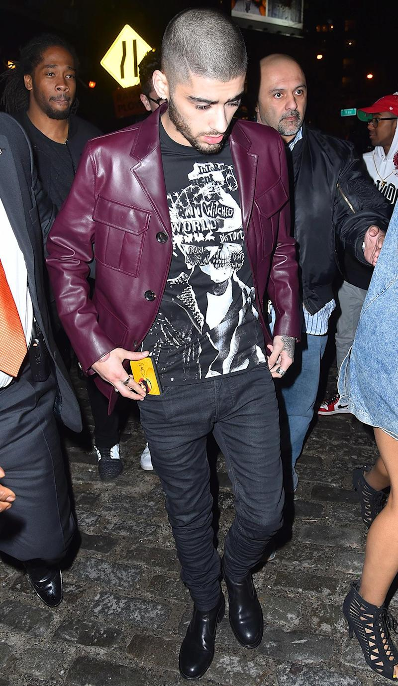 Wearing a Bally jacket, Dsquared2 shirt, and Diesel jeans.