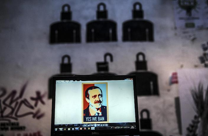 """A computer screen shows a digital portrait of the Turkish Prime Minister Recep Tayyip Erdogan and text reading """"Yes we ban"""" in Istanbul, on March 27, 2014, the day Turkey banned video sharing website YouTube (AFP Photo/Ozan Kose)"""