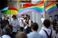 People take part in a rally in support of the LGBT community in Lodz