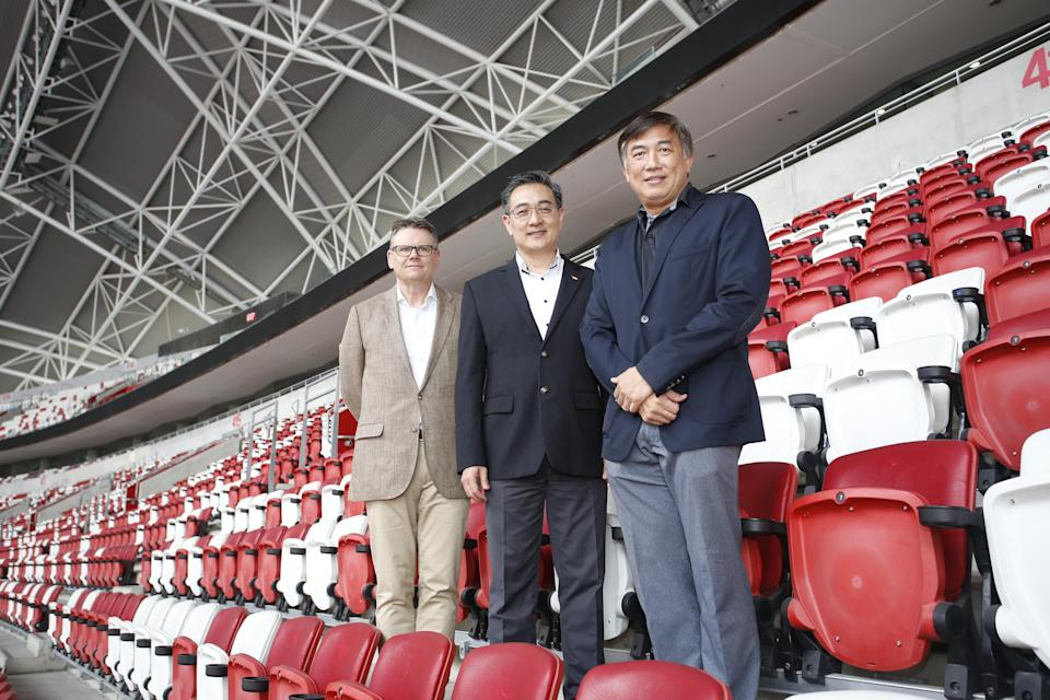 (L to R) Sports Hub Chairman Bryn Jones,Sports Hub CEO Oon Jin Teik, and Sport Singapore CEO Lim Teck Yin at the National Stadium. (Photo: Sports Hub)