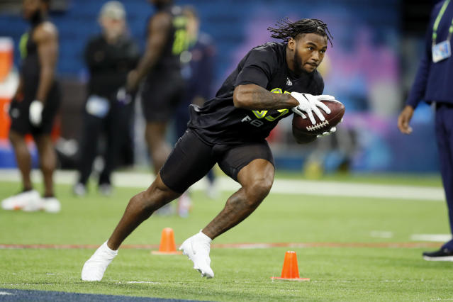 FILE - In this Feb. 28, 2020, file photo, Georgia running back D'Andre Swift runs a drill at the NFL football scouting combine in Indianapolis. Swift was chosen by the Detroit Lions in the second round of the NFL football draft Friday, April 24, 2020. (AP Photo/Charlie Neibergall, File)