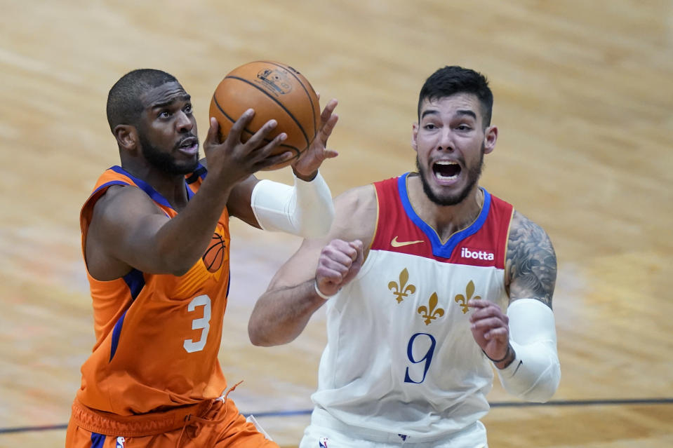 Phoenix Suns guard Chris Paul (3) drives to the basket against New Orleans Pelicans center Willy Hernangomez (9) during the second half of an NBA basketball game in New Orleans, Friday, Feb. 19, 2021. (AP Photo/Gerald Herbert)