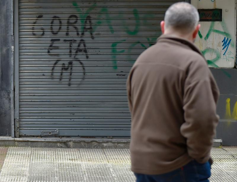 A man walks past a pro-ETA graffiti in the village of Hernani in Spain's Basque Country