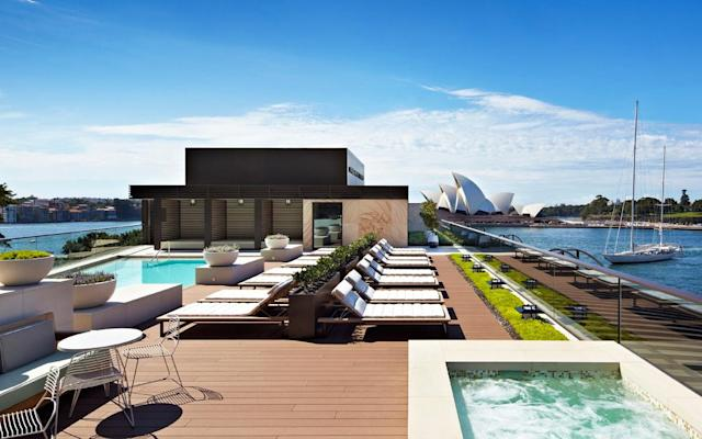 Park Hyatt's rooftop pool is flanked by cabanas and deckchairs with views of Sydney Harbour