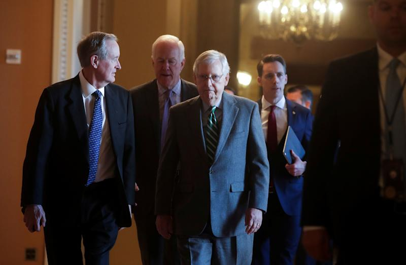 Senate Majority Leader Mitch McConnell and other Republican senators before the procedural start of the impeachment trial of U.S. President Donald Trump. (Photo: Jonathan Ernst / Reuters)
