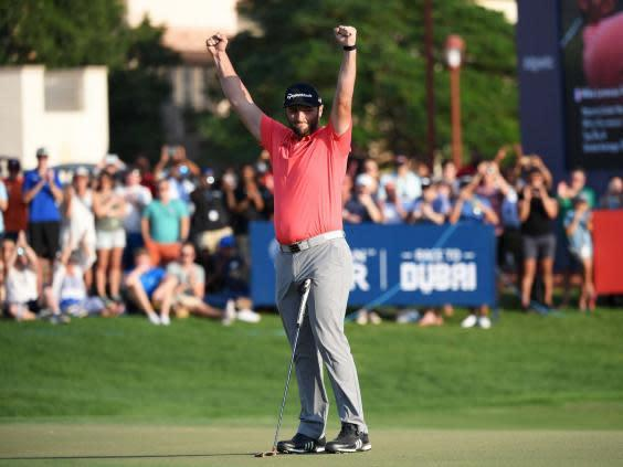 Jon Rahm celebrates on the 18th green (Getty)