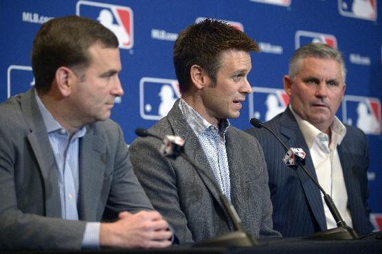 Chicago White Sox general manager Rick Hahn, left, Los Angeles Angels general manager Jerry Dipoto, center, and Arizona Diamondbacks general manager Kevin Towers address reporters after announcing a trade between the three clubs at baseball's winter meetings in Lake Buena Vista, Fla., Tuesday, Dec. 10, 2013. The Diamondbacks have agreed to acquire outfielder Mark Trumbo from the Angels, with Hector Santiago moving from the White Sox to the Angels, outfielder Adam Eaton from Arizona to Chicago and pitcher Tyler Skaggs from Arizona to Los Angeles. (AP Photo/Phelan M. Ebenhack)