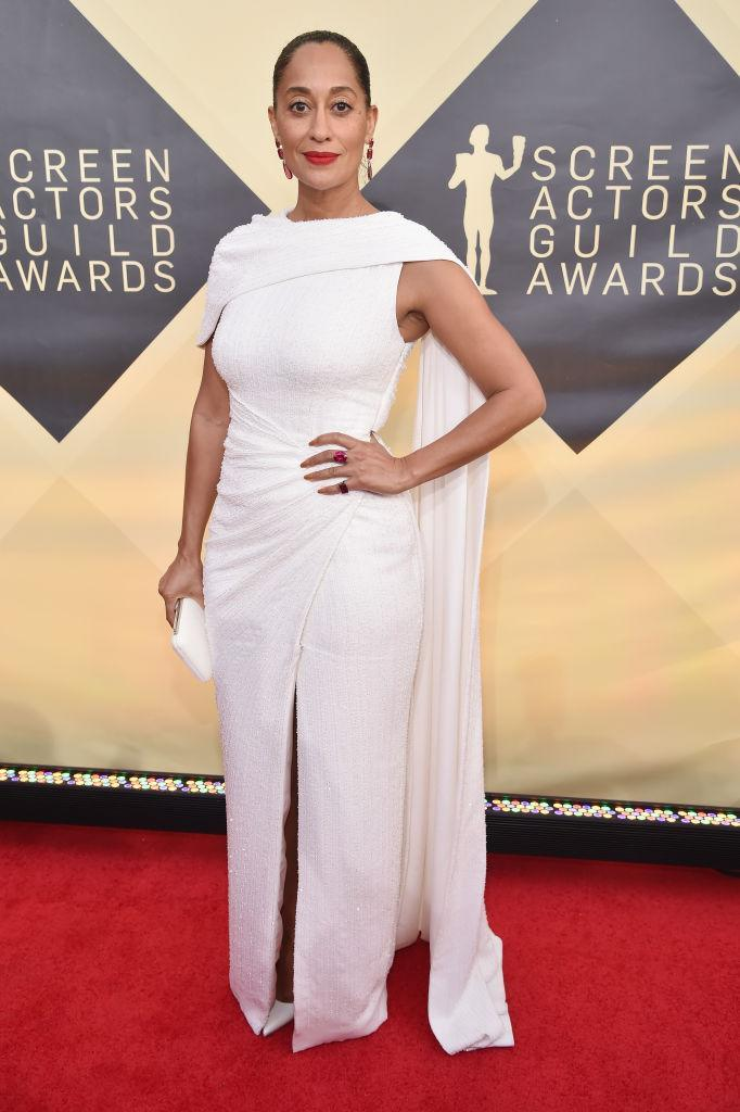<p>Ross wore a white dress with a train off one shoulder. (Photo: Getty Images) </p>