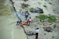 Families in India's north and east gave up the bodies of their loved ones to the Ganges river, or buried them in shallow graves on its banks, unable to afford the cost of funeral pyres during the height of the coronavirus outbreak