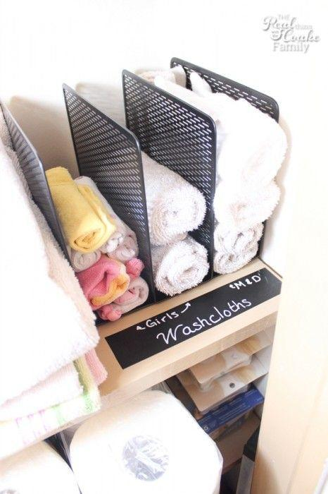 """<p>If you're particular about who uses washcloths in your home, ease your mind with the roll-and-file method. Tall shelf dividers help keep everything categorized.</p><p><a href=""""http://www.realcoake.com/2014/09/linen-closet-organization.html#_a5y_p=2593382"""" rel=""""nofollow noopener"""" target=""""_blank"""" data-ylk=""""slk:See more at The Real Thing With The Coake Family »"""" class=""""link rapid-noclick-resp""""><em>See more at The Real Thing With The Coake Family »</em></a></p>"""