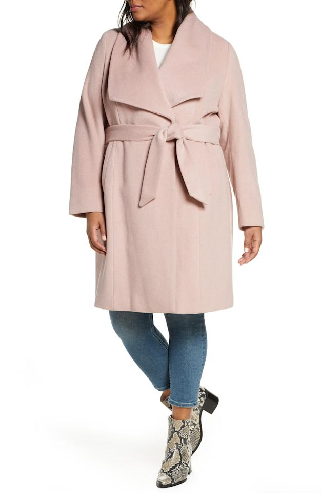 "<p>Stay cozy in this dreamy <a href=""https://www.popsugar.com/buy/Cole-Haan-Signature-Slick-Wool-Blend-Wrap-Coat-486661?p_name=Cole%20Haan%20Signature%20Slick%20Wool%20Blend%20Wrap%20Coat&retailer=shop.nordstrom.com&pid=486661&price=450&evar1=fab%3Aus&evar9=46570821&evar98=https%3A%2F%2Fwww.popsugar.com%2Ffashion%2Fphoto-gallery%2F46570821%2Fimage%2F46571321%2FCole-Haan-Signature-Slick-Wool-Blend-Wrap-Coat&list1=shopping%2Cfall%20fashion%2Cfall%20trends%2Cfall%2Ccurve%2Ccurve%20fashion&prop13=mobile&pdata=1"" rel=""nofollow"" data-shoppable-link=""1"" target=""_blank"" class=""ga-track"" data-ga-category=""Related"" data-ga-label=""https://shop.nordstrom.com/s/cole-haan-signature-slick-wool-blend-wrap-coat-plus-size/5340311?origin=category-personalizedsort&amp;breadcrumb=Home%2FWomen%2FClothing%2FPlus-Size%20Clothing%2FAll%20Plus-Size%20Clothing&amp;color=dusty%20rose"" data-ga-action=""In-Line Links"">Cole Haan Signature Slick Wool Blend Wrap Coat</a> ($450).</p>"