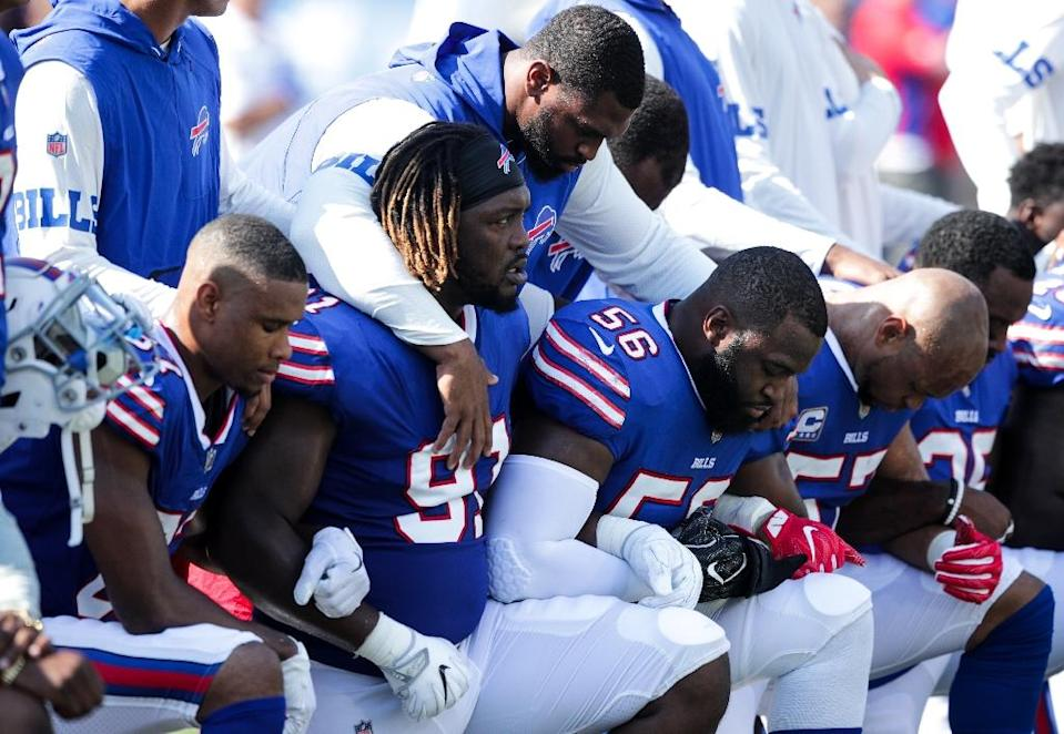 Buffalo Bills players kneel during the national anthem before a game against the Denver Broncos in September (AFP Photo/Brett Carlsen)