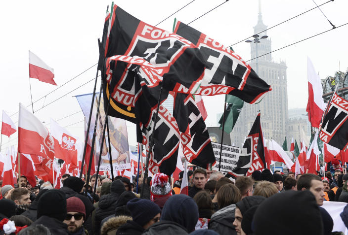 Members of the Italian Forza Nouva walk in the annual March of Independence organized by Polish far right activists to celebrate 100 years of Poland's independence. (AP Photo/Alik Keplicz)