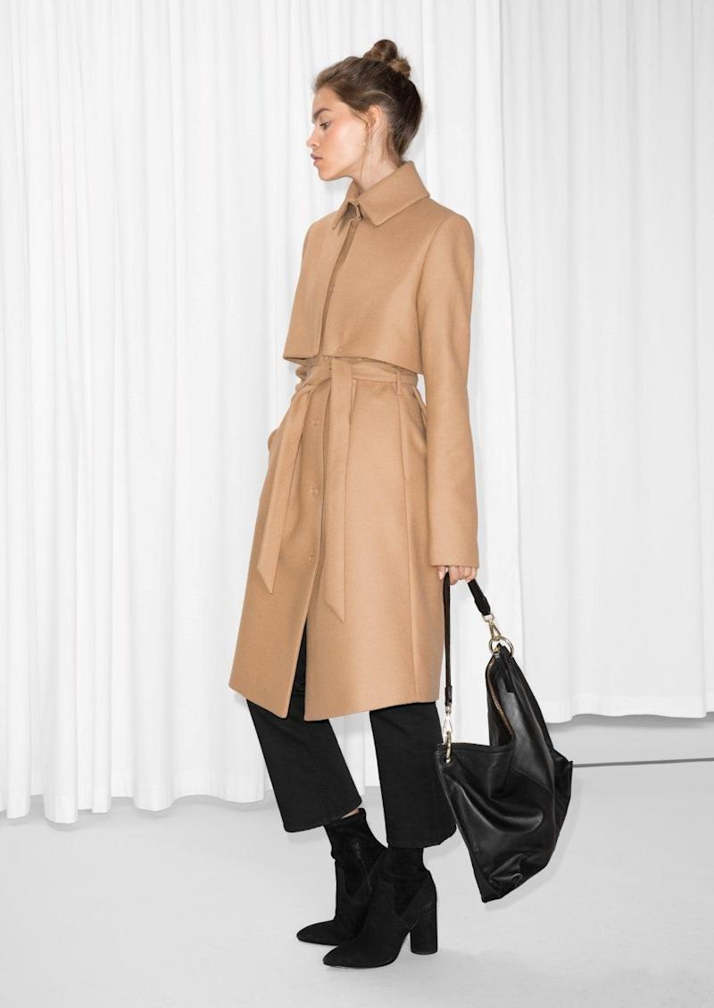 "It's <a href=""https://www.stories.com/us/Ready-to-wear/Outerwear/Wool_Trenchcoat/582949-0167979007.2"" target=""_blank"">everything you want out of a trench coat</a>: comfortable, stylish, sleek, and actually warm."