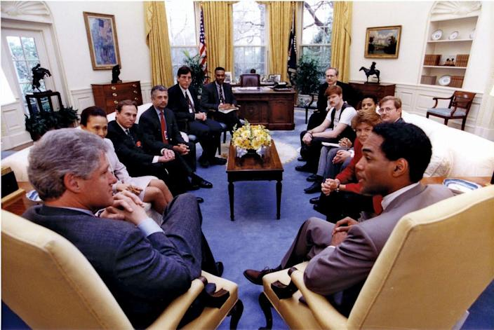 President Bill Clinton meets with lesbian and gay leaders in 1992, including AIDS activist Phill Wilson (at right with back to camera), who founded the Black AIDS Institute.