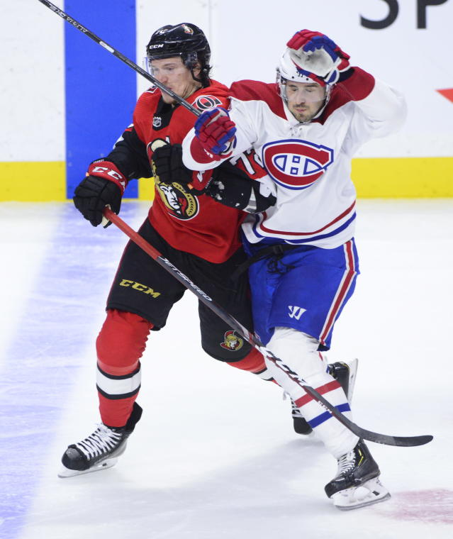 Ottawa Senators defenseman Thomas Chabot (72) holds back Montreal Canadiens center Phillip Danault (24) during the second period of an NHL hockey game Saturday, Jan. 11, 2020, in Ottawa, Ontario. (Sean Kilpatrick/The Canadian Press via AP)