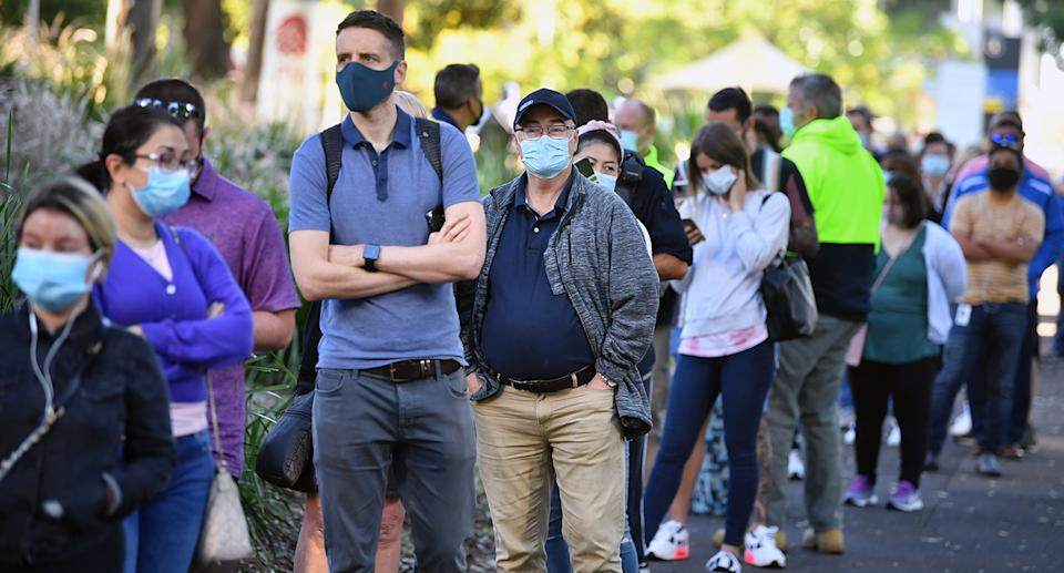 A queue forms outside at a mass COVID-19 vaccination hub in Sydney, Monday, May 10, 2021. The hub will be open to people in categories 1a and 1b before expanding to anyone over 50 from May 24. (AAP Image/Joel Carrett) NO ARCHIVING