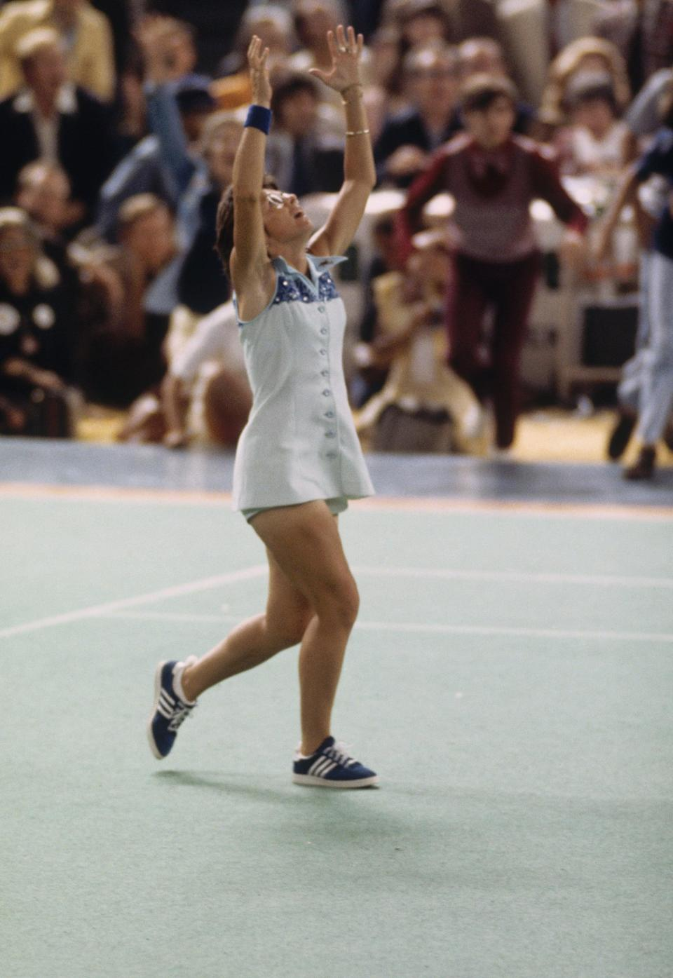 """<p>Billie Jean King famously beat Bobby Riggs in their $100,000 winner-take-all """"Battle of the Sexes"""" tennis match, which took place September 20, 1973. King's designer for the match, legendary British tennis couturier Ted Tinling, brought along a shimmering dress that King looked great in, but she felt it was too scratchy. That's how the back-up option was introduced: <a href=""""https://www.smithsonianmag.com/arts-culture/how-billie-jean-king-picked-her-outfit-for-the-battle-of-the-sexes-match-89938552/"""" class=""""link rapid-noclick-resp"""" rel=""""nofollow noopener"""" target=""""_blank"""" data-ylk=""""slk:this nylon dress"""">this nylon dress</a> that paid homage to the Virginia Slims Women's Tennis Tour. The morning of the match, Tingling searched high and low for rhinestones to stitch onto it, according to his memoir. """"I would never have worn pink,"""" Billie Jean King famously said of the historical moment.</p>"""