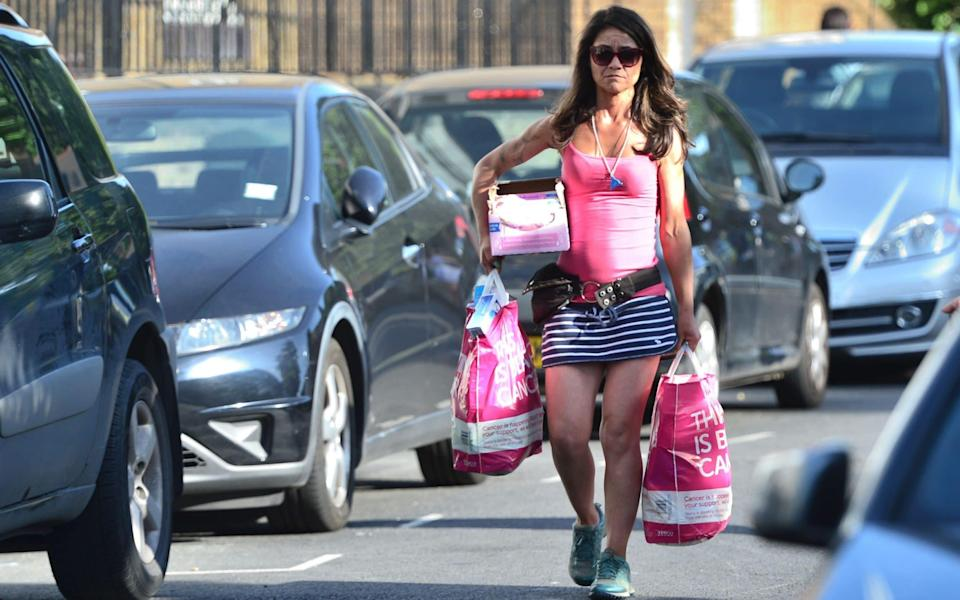 People bring donations to Rugby Portobello Centre - Credit: PA