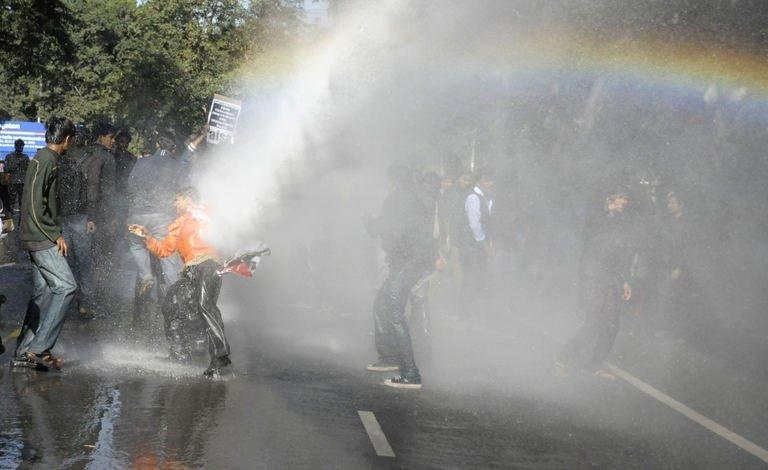 Indian police used a water canon as protesters tried to tear down steel barricades in Delhi on December 19, 2012