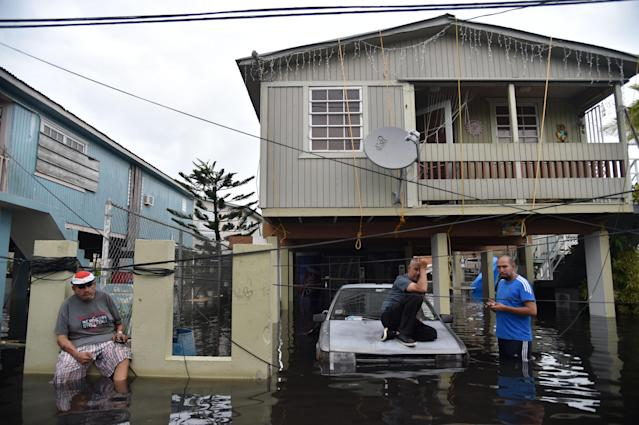 Inhabitants stand in floodwater in Cataño, Puerto Rico, Sept. 21, 2017. (Photo: Hector Retamal/AFP/Getty Images)