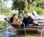 <p>Elvis Presley smiles as he and his wife, Priscilla Presley, play with their daughter Lisa Marie while on vacation in Hawaii in 1968. </p>