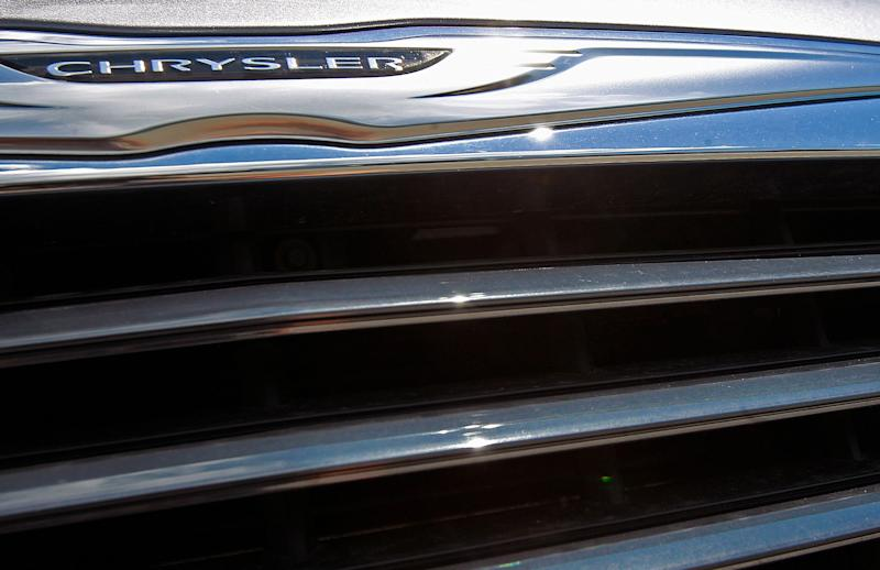 In this Monday, July 29, 2013, photo, a Chrysler 300 sits on the lot of Midstate Motors in Berlin, Vt. Chrysler reports quarterly earnings on Tuesday, July 30, 2013. (AP Photo/Toby Talbot)