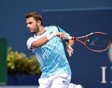 Aug 7, 2014; Toronto, Ontario, Canada; Stan Wawrinka (SUI) hits a forehand against Kevin Anderson (RSA) on day four of the Rogers Cup tennis tournament at Rexall Centre. Mandatory Credit: Peter Llewellyn-USA TODAY Sports