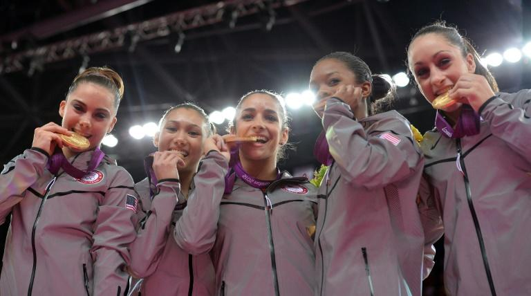 McKayla Maroney (L) and her gymnastics teammates with their gold medals at the 2012 London Olympics