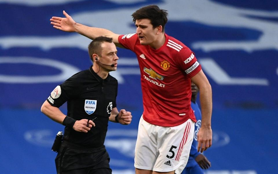 Stuart Attwell andHarry Maguire —Ole Gunnar Solskjaer hits out at Var conspiracy, insisting Chelsea website influenced referee in goalless draw - GETTY IMAGES