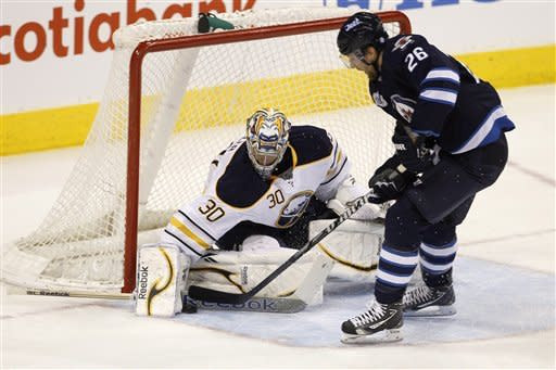 Buffalo Sabres goaltender Ryan Miller makes a blocker save on Winnipeg Jets' Blake Wheeler (26 )during the first period of an NHL hockey game in Winnipeg, Manitoba, Monday, March 5, 2012. (AP Photo/The Canadian Press, Trevor Hagan)