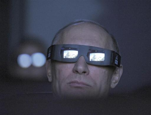 Russia's Prime Minister and President-elect Vladimir Putin, wearing a pair of glasses, watches the main program of the Planetarium on the Day of Aviation and Cosmonautics and the 51st anniversary of Yuri Gagarin's historic first space flight in Moscow April 12, 2012.