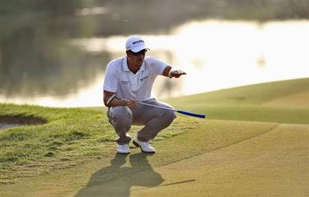Stenson of Sweden lines the ball on the 16th green during the third round of the DP World Tour Championship in Dubai