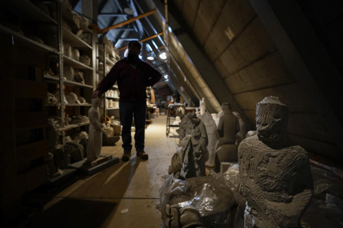 Stone carver Sean Callahan stands among construction archives at the Washington National Cathedral, Friday, March 19, 2021. (AP Photo/Carolyn Kaster)