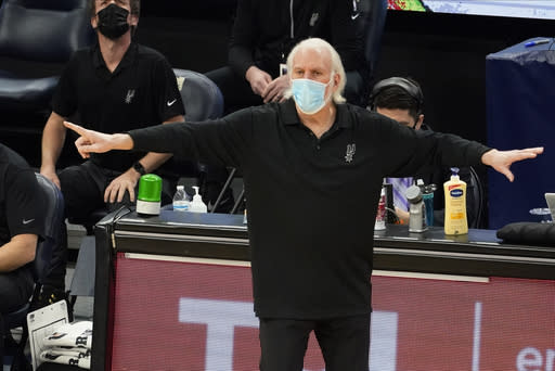 San Antonio Spurs head coach Gregg Popovich directs his team against the Minnesota Timberwolves in the second half of an NBA basketball game Saturday, Jan. 9, 2021, in Minneapolis. (AP Photo/Jim Mone)
