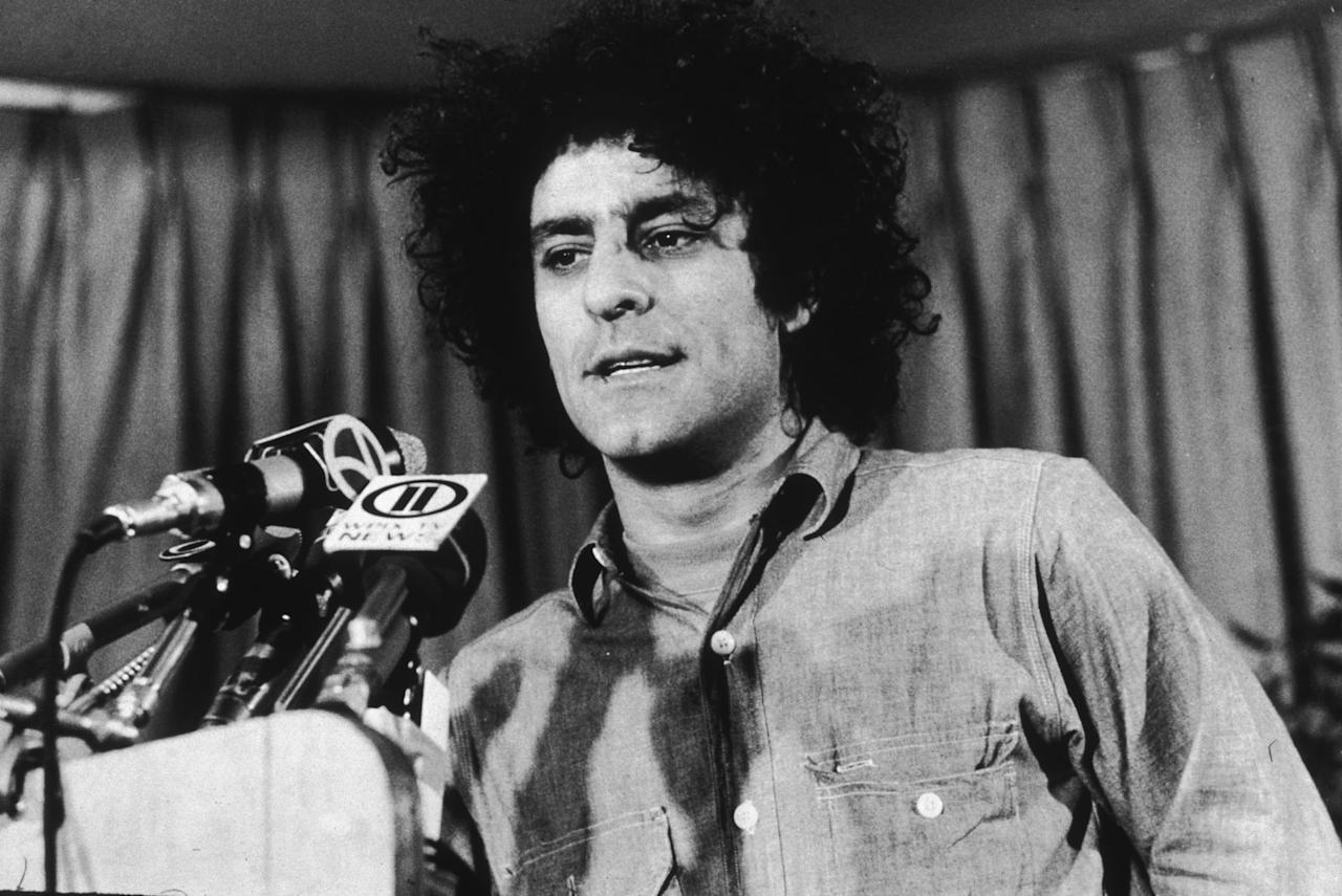 "<p>Around 1968, Abbie Hoffman (<a class=""sugar-inline-link ga-track"" title=""Latest photos and news for Sacha Baron Cohen"" href=""https://www.popsugar.com/Sacha-Baron-Cohen"" target=""_blank"" data-ga-category=""internal click"" data-ga-label=""https://www.popsugar.com/Sacha-Baron-Cohen"" data-ga-action=""body text link"">Sacha Baron Cohen</a>) cofounded the <a href=""http://content.time.com/time/specials/packages/article/0,28804,1846670_1846800_1846915,00.html"" style=""background-color: rgb(255, 255, 255);"" target=""_blank"" class=""ga-track"" data-ga-category=""internal click"" data-ga-label=""http://content.time.com/time/specials/packages/article/0,28804,1846670_1846800_1846915,00.html"" data-ga-action=""body text link"">Youth International Party</a> (""Yippies"") to protest the Vietnam War. Before violence broke out, Hoffman and Jerry Rubin unveiled <a href=""https://www.britannica.com/biography/Abbie-Hoffman"" style=""background-color: rgb(255, 255, 255);"" target=""_blank"" class=""ga-track"" data-ga-category=""internal click"" data-ga-label=""https://www.britannica.com/biography/Abbie-Hoffman"" data-ga-action=""body text link"">Pigasus</a>, a boar hog that was to be the Yippies' presidential candidate in 1968. After getting arrested for trying to sell $36,000 worth of cocaine, he jumped bail in 1974. In the '80s, he reinvented himself as <product href=""https://www.pbs.org/opb/thesixties/topics/revolution/newsmakers_2.html"" style=""background-color: rgb(255, 255, 255);"" target=""_blank"" class=""ga-track"" data-ga-category=""internal click"" data-ga-label=""https://www.pbs.org/opb/thesixties/topics/revolution/newsmakers_2.html"" data-ga-action=""body text link"">Barry Freed</product> and underwent plastic surgery for a totally different look. He spent his last years as an environmental activist and died in 1989 from a phenobarbital overdose. </p>"