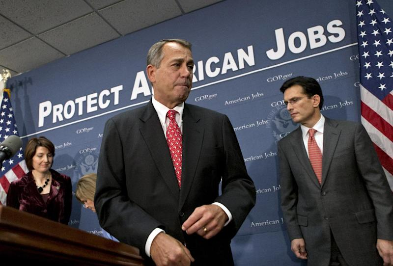 Speaker of the House John Boehner, R-Ohio, joined by Rep. Cathy McMorris Rodgers, left, and House Majority Leader Eric Cantor, R-Va., right, as they finish a news conference about the fiscal cliff negotiations after a closed-door GOP strategy session, at the Capitol in Washington, Tuesday, Dec. 18, 2012.   (AP Photo/J. Scott Applewhite)
